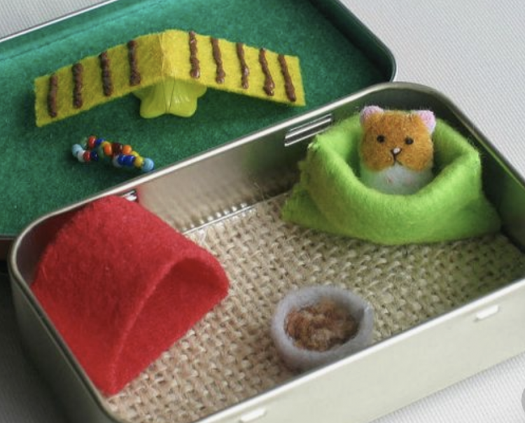 teeny hamster house out of a candy tin