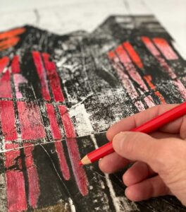hand coloring a drawing of a building