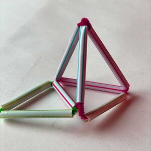 small structure made of straws and pipe cleaners
